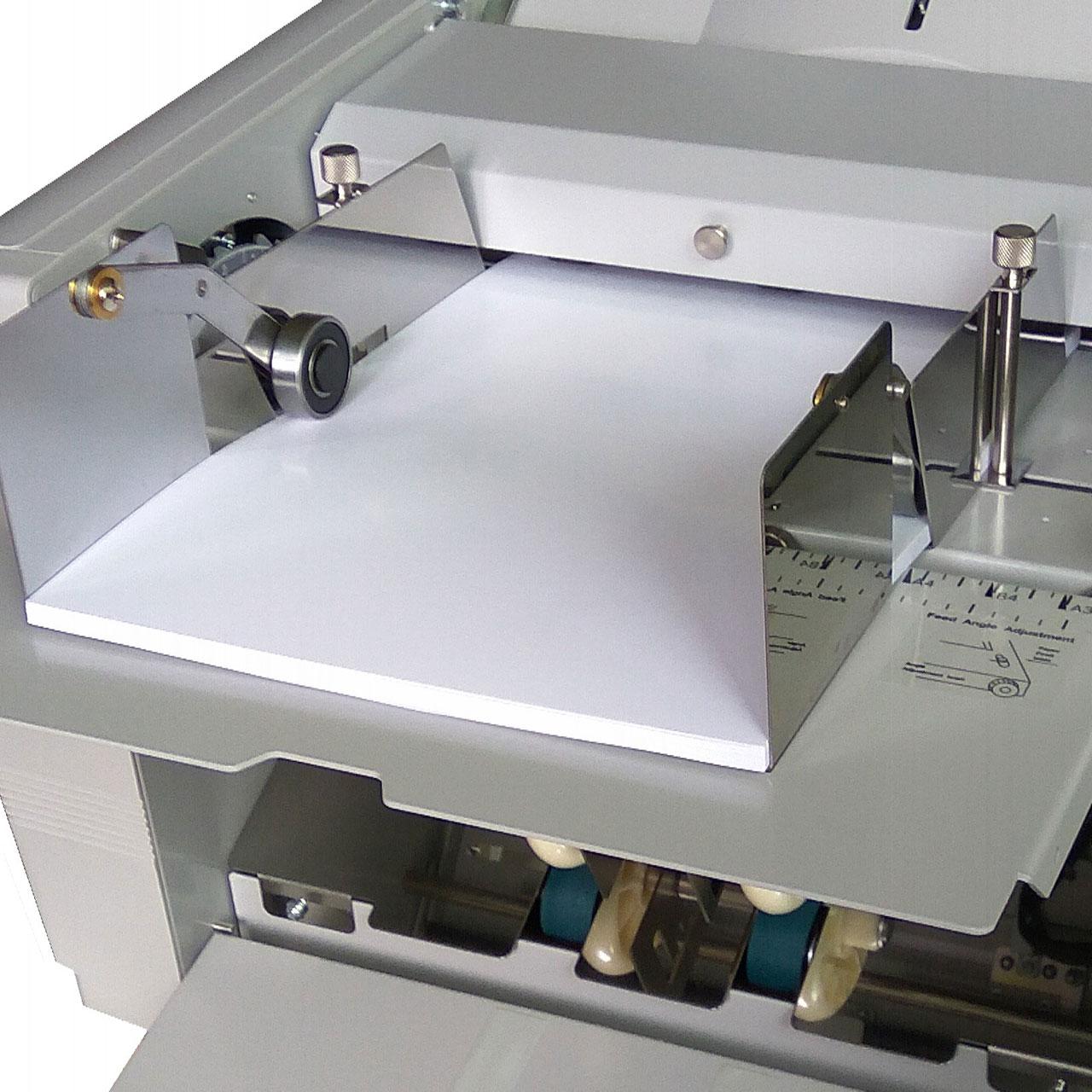 Linke und rechte Zusatz-Papierführung für SUPERFAX Falzmaschinen.